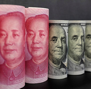 US 100 dollar banknotes and Chinese 100 yuan banknotes are seen in this picture illustration in Beijing, China, January 21, 2016.