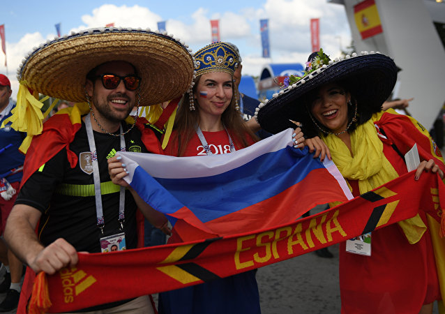 Soccer fans cheer waiting for the start of the World Cup Round of 16 soccer match between Russia and Spain outside the Luzhniki stadium in Moscow, Russia, July 1, 2018