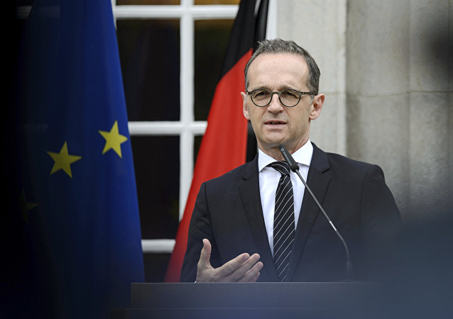 German Foreing Minister Heiko Maas addresses the media during a joint press conference with his counterpart from Hungary, Peter Szijjarto, as part of a meeting in Berlin, Germany, Tuesday, June 5, 2018