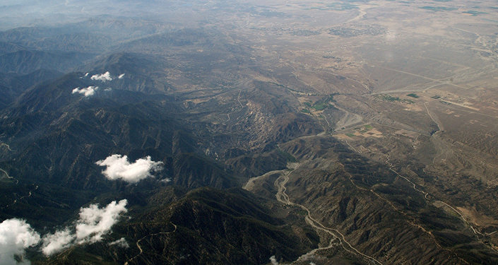 The San Andreas Fault runs west-northwest toward the Big Bend where it turns northwest beyond the pinched far west end of the Mojave Desert