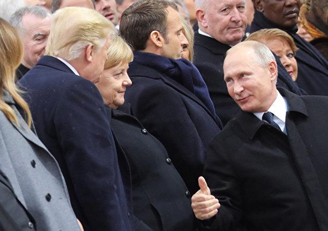 Trump, Merkel, Putin, Macron a Parigi