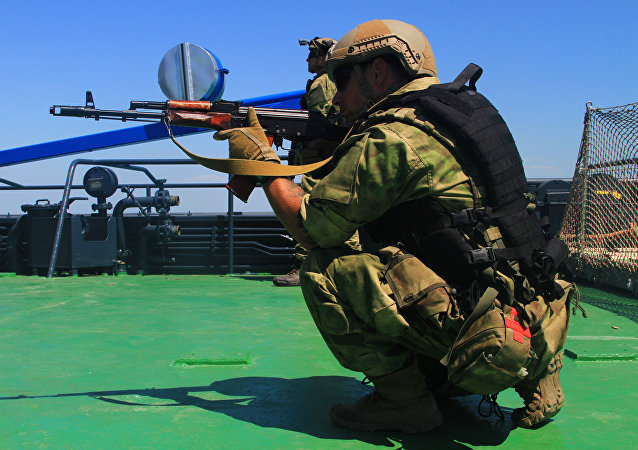 During visit, board, search and seizure training in the Black Sea, a Ukrainian SOF Operator provides security alongside U.S. SOF, July 19, 2017 during exercise Sea Breeze. Sea Breeze is a U.S. and Ukraine co-hosted multinational maritime exercise held in the Black Sea and is designed to enhance interoperability of participating nations and strengthen maritime security within the region.