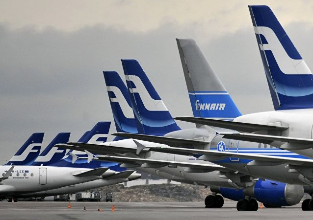 Passenger planes of the Finnish national airline company Finnair stand on the tarmac at Helsinki international airport, Helsinki, Finland