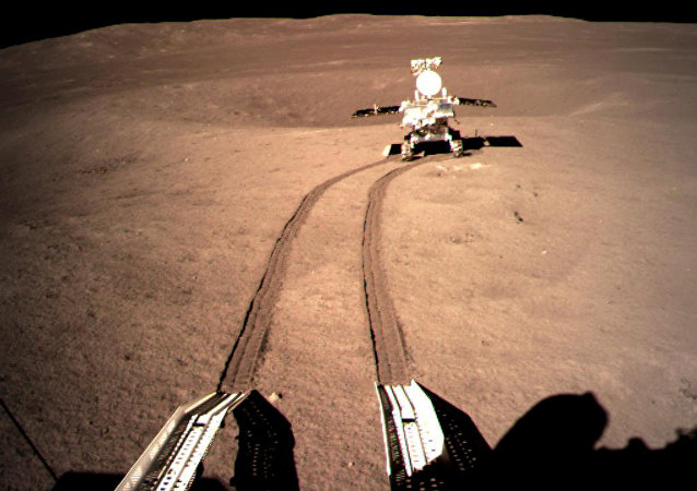 China's lunar rover Yutu-2, or Jade Rabbit 2 rolling onto the far side of the moon taken by the Chang'e-4 lunar probe is seen in this image provided by China National Space Administration January 4, 2019.