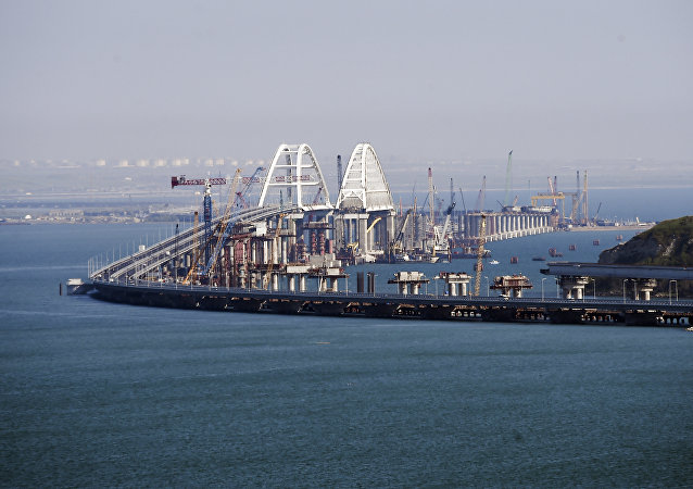A view of the new bridge across the Kerch Strait linking Russia's Taman Peninsula with Crimea, after regular traffic began, in Kerch, Crimea, Wednesday, May 16, 2018.