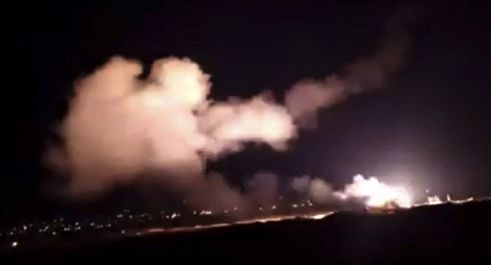 This frame grab from a video provided by the Syrian official news agency SANA shows missiles flying into the sky near Damascus, Syria, Tuesday, Dec. 25, 2018