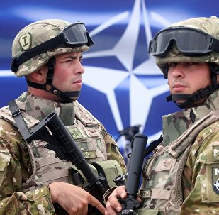 Georgian servicemen stand at the opening of a joint NATO-Georgia training center outside Tbilisi, Georgia, Thursday, Aug. 27, 2015