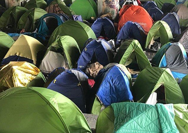 Tendopoli di migranti