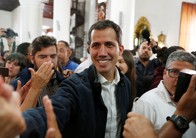 Venezuelan opposition leader and self-proclaimed interim president Juan Guaido arrives to attend a holy mass in Caracas, Venezuela, January 27, 2019