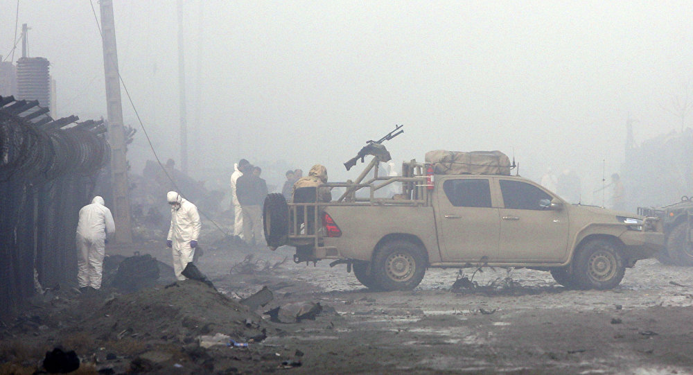Security forces inspect the site of a suicide bomb attack in Kabul, Afghanistan, Thursday, Nov. 29, 2018. Taliban insurgents staged a coordinated attack targeting a security firm in the Afghan capital on Wednesday, killing people and wounding others.