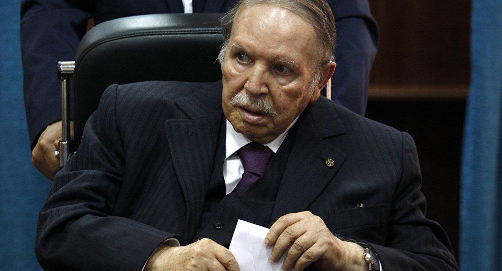In this May 4, 2017 file photo, Algerian President Abdelaziz Bouteflika prepares to vote in Algiers.