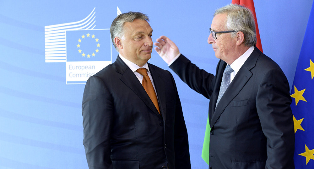 Hungary's Prime Minister Viktor Orban (L) is greeted by European Union Commission President Jean-Claude Juncker of Luxembourg prior to their meeting at the European Union Commission headquarter in Brussels on September 3, 2015