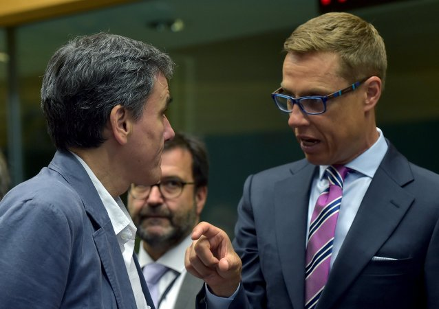 Ministro delle finanze Euclid Tsakalotos (a sinistra)