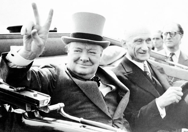 Former British Prime Minister Winston Churchill, gives his world famous V-sign