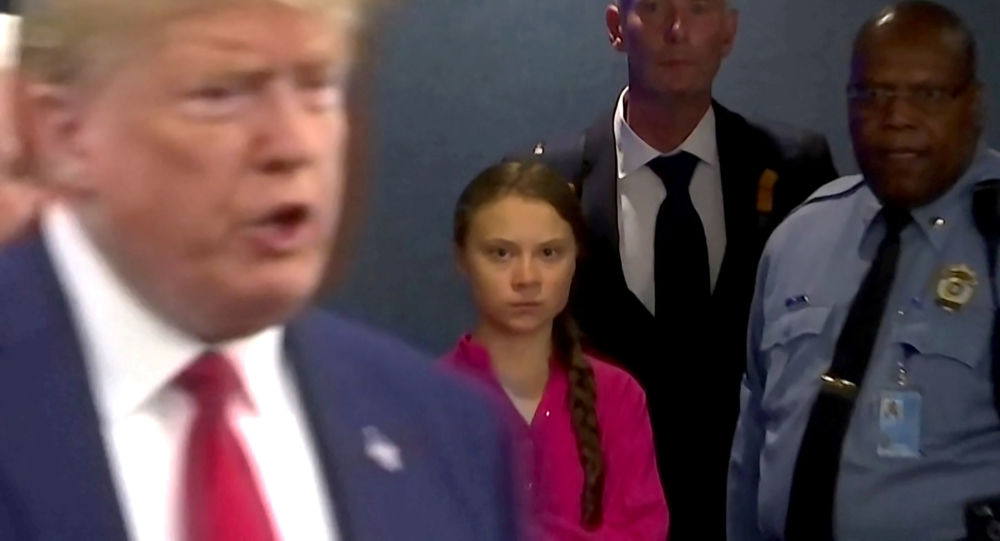 Swedish environmental activist Greta Thunberg watches as U.S. President Donald Trump enters the United Nations to speak with reporters in a still image from video taken in New York City, U.S. September 23, 2019