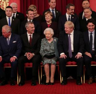 I leader dei Paesi Nato al ricevimento di Buckingham Palace