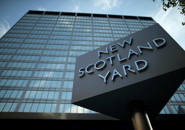 A sign rotates outside New Scotland Yard