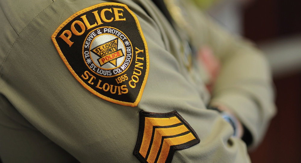 A St. Louis County Police Officer listens during a press conference on March 12, 2015 in Clayton, Missouri.